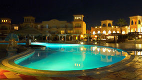 Egypt - Luxury Hotel Resort Red Sea Night. Part of building a luxury hotel complex with a swimming pool by night. Egypt - near the Red Sea coral reef stock photography