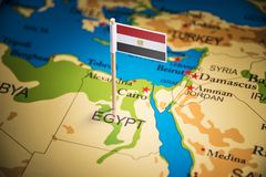 Egypt marked with a flag on the map.  royalty free stock image