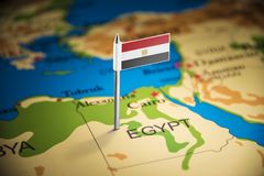 Egypt marked with a flag on the map.  stock photo