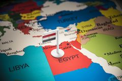 Egypt marked with a flag on the map.  royalty free stock images