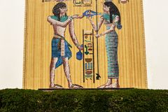 Egypt motive mosaic on a big wall made of golden plates royalty free stock photos