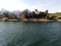 Egypt Nile cruise. Fire happened in the village. View from the r Stock Photos