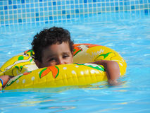 Boy play at swimming Pool. Egypt, Nov. 23 2014 : Happy people and girls in bikini enjoying bath time in pool, Sharm el-Sheikh Royalty Free Stock Image