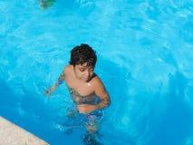 Boy at Swimming Pool. Egypt, Nov. 23 2014 : Happy people and girls in bikini enjoying bath time in pool, Sharm el-Sheikh Royalty Free Stock Images