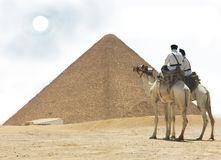Egypt - pyramid and two cops. Egypt -  Cairo, Giza - two cops on camel Royalty Free Stock Photography
