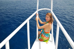 Egypt. Red sea. Beautiful girl at white yacht. Egypt. Red sea. Beautiful girl is sitting on the rostrum of white yacht royalty free stock images