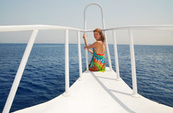 Egypt. Red sea. Beautiful girl at white yacht. Egypt. Red sea. Beautiful girl is sitting on the rostrum of white yacht Royalty Free Stock Photos