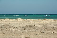 Egypt - Sea next to the road. Driving through Egypt to the airport. I saw beautiful sea view on the boats floating royalty free stock image