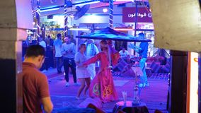 Egyptian man circling with skirt dance for tourists in the street restaurant at Naama Bay. Egypt, Sharm El Sheikh, April 8, 2019: Egyptian man circling with stock video footage