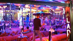 Egyptian mans dance for tourists in the street restaurant at Naama Bay. EGYPT, SHARM EL SHEIKH, APRIL 8, 2019: Egyptian mans dance for tourists in the street stock video footage
