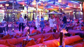 Egyptian mans dance for tourists in the street restaurant at Naama Bay. EGYPT, SHARM EL SHEIKH, APRIL 8, 2019: Egyptian mans dance for tourists in the street stock footage