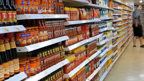 Goods and products on display in a supermarket store shelves stock footage