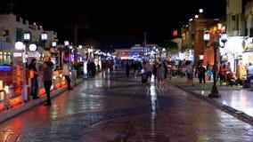 Night life in Naama Bay Street, Egypt, Sharm el Sheikh. EGYPT, SHARM EL SHEIKH, APRIL 8, 2019: Night life in Naama Bay Street. Tourists walk near the stalls with stock video