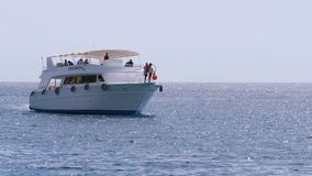 Pleasure boat with tourists on board is sailing in the Red Sea, Egypt. stock video