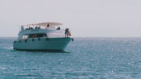 Pleasure boat with tourists on board is sailing in the Red Sea, Egypt. stock video footage