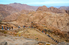 Egypt, Sinai Mountains. People go down from the top of Mount Mos Royalty Free Stock Image
