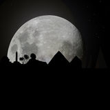 Egypt skyline by night with moon Royalty Free Stock Photography
