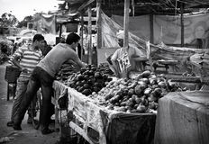 Egypt Street Market Scene. Hurghada, Egypt - 6th April 2012 - two men are buying vegetable from a market stall Royalty Free Stock Photo