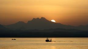 Egypt sunset. Sea boat sun mountains Stock Image