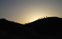Egypt sunset. People mountains evening Stock Photos