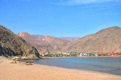 Egypt, Taba. Beach on a background of mountains Stock Images