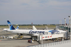 EgyptAir Boeing 777 aircraft at the gate at John F Kennedy International Airport. NEW YORK- JULY 10  EgyptAir Boeing 777 aircraft at the gate at John F Kennedy Royalty Free Stock Photography