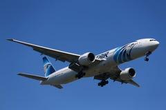 EgyptAir Boeing 777 descends for landing at JFK International Airport in New York Royalty Free Stock Images