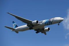 EgyptAir Boeing 777 descends for landing at JFK International Airport in New York Stock Photography