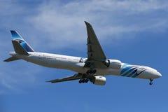 EgyptAir Boeing 777 descends for landing at JFK International Airport in New York Royalty Free Stock Image