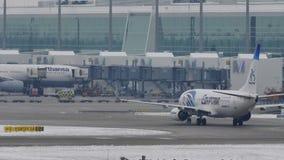 EgyptAir Boeing 737-800 SU-GEH taxiing in Munich Airport, MUC. EgyptAir doing taxi in Munich Airport, MUC, snow on runway stock video footage