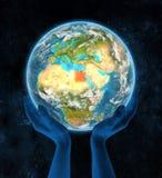 Egypte op aarde in handen Stock Foto