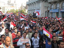 Egyptenaren die de berusting van Mubarak verzoeken Stock Afbeelding