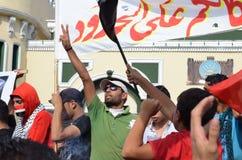 Egyptenaren die krijgswet protesteren Stock Afbeeldingen