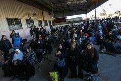 Egyptian authorities reopen the sole passenger crossing between Gaza and Egypt in both directions today. Palestinians wait to leave Gaza through Rafah border stock photos
