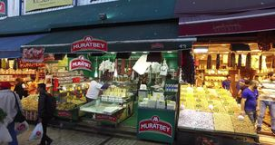 Egyptian Bazaar. STANBUL, TURKEY - 5 APRIL  2016: Egyptian market stores and pastry spice sweets and tea in Istanbul: April 5, 2016 in Istanbul, Turkey stock video footage