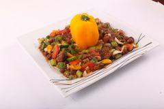Egyptian Bean meal. With tomatoes and Vegetables on white plate Royalty Free Stock Image