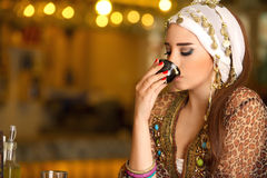 Egyptian beautiful woman drinking coffee Stock Photography