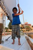 Egyptian boy on boat royalty free stock photography