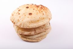 Egyptian bread Loaves. Over white background royalty free stock photography