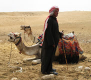 Egyptian camel minder. Waiting for tourists at Giza near the great pyramids Royalty Free Stock Images
