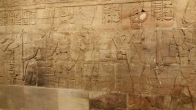 Egyptian carving on stone wall. Egyptian carving on a stone wall Stock Photo