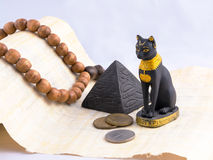 Egyptian cat, a pyramid and papyrus from travels. Royalty Free Stock Photos