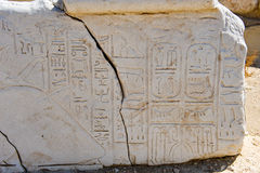 Egyptian characters on stone. Stone with egyptian characters found in the old tell of Beit She'An in Galilee in Israel Royalty Free Stock Photos