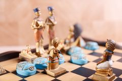 Egyptian chess figures on the board stock photo