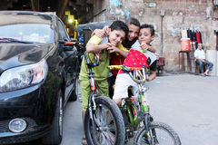 Egyptian children with bicycles Stock Image