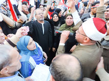 Egyptian Christian and Muslims share Egyptian revolution Royalty Free Stock Photo
