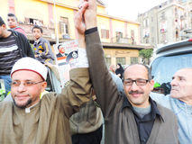 Egyptian Christian and Muslims share Egyptian revolution Stock Image