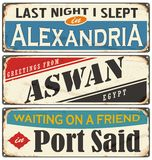 Egyptian cities and travel destinations. Retro metal plates set on old damaged background royalty free illustration