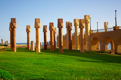 Egyptian columns. On green grass Stock Images
