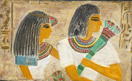 Egyptian couple. Egyptian man and woman on papyrus Royalty Free Stock Photo